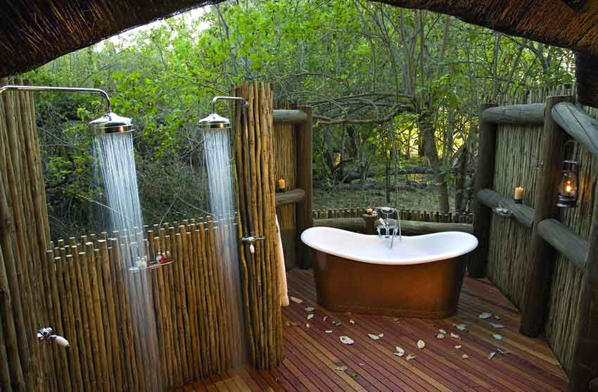 outdoor shower with copper bathtub