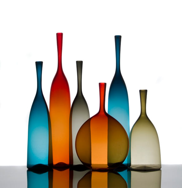 colorful glass bottles in red and blue by cariati
