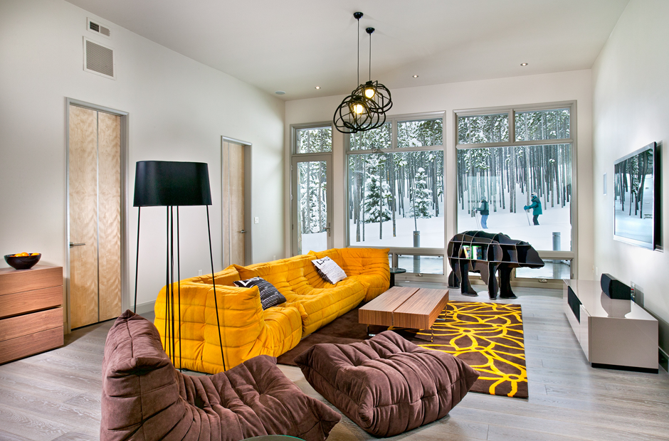Living room of Peak 8 Ski lodge - interior featues togo sofas and is designed by Donna Grace McAlear of new mood design