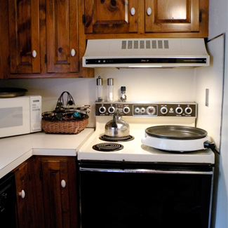 Before and after updated condo kitchen, Linda Merrill, Massachusetts
