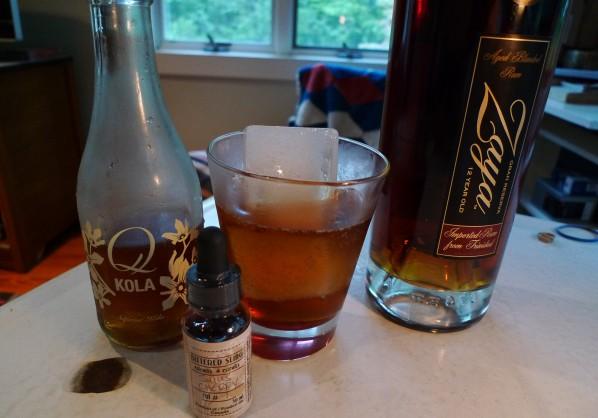 Zaya Rum, Q-Kola, Bitter Sling Cherry Bitters and Mavea Water Ice Cubes