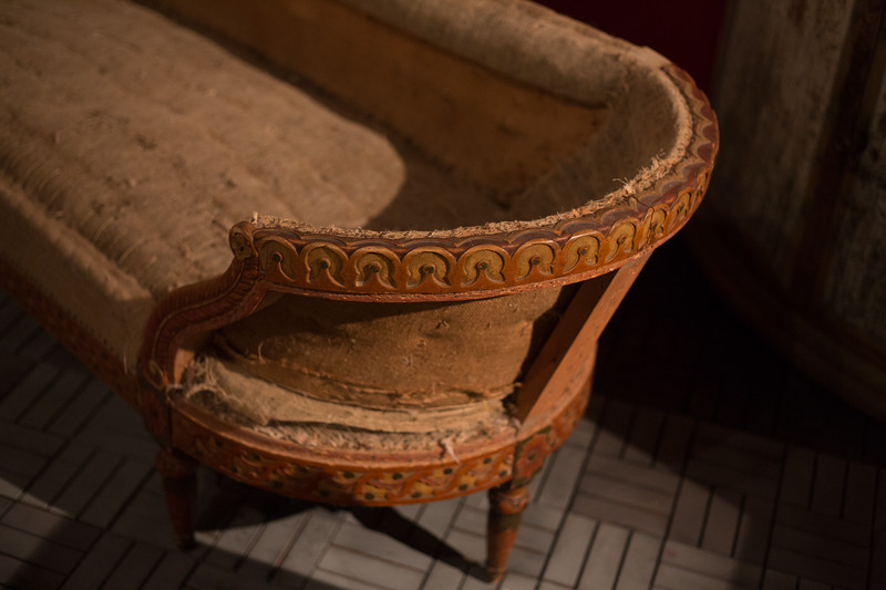 1830's carved walnut chaise with painted accents