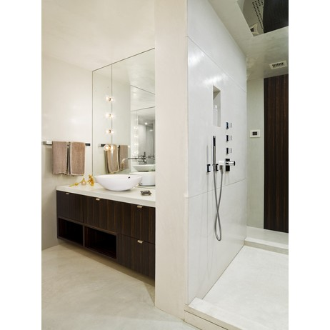 Shower encasement and vanity top by Concreteworks East Studio