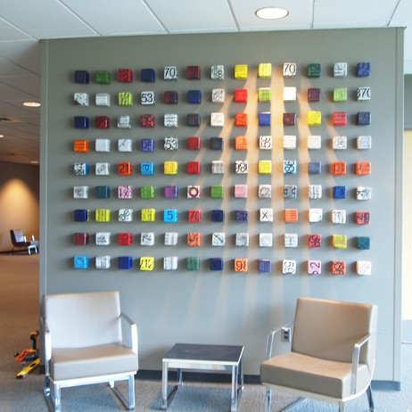 commercial client cube wall installation by Next Step Studio & Gallery