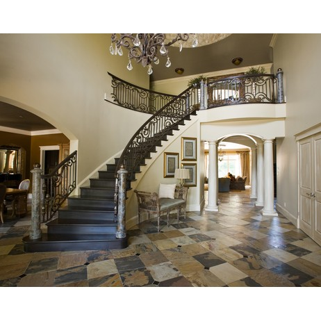 Grand Staircase Railing  by Compass Ironworks