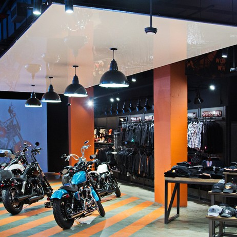 SUSPENDED STRETCH CEILING PANELS IN HARLEY DAVIDSON SHOWROOM by NYCeiling, Inc.