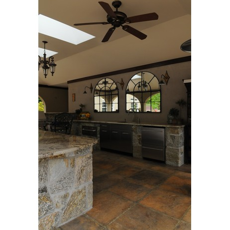 Outdoor covered kitchen cabinetry by Preferred Properties Lsc, inc