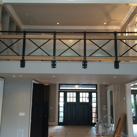 Steel / Distressed Wood Balcony by Mac Metalworks Inc.
