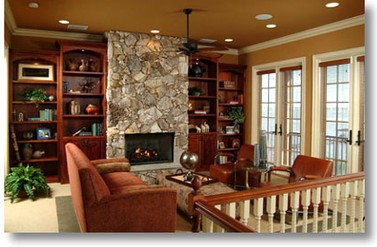 River front home library - Clay Stephens Lifestyles